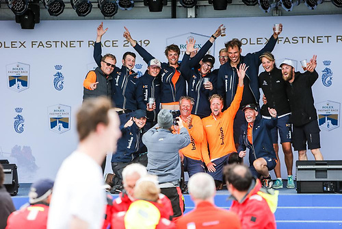 Rolex RORC photographer Paul Wyeth captures teams at the prizegiving as they express their joy after successfully completing the Rolex Fastnet Race - for many it will be their greatest personal challenge