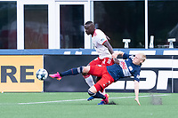 FOXBOROUGH, MA - JUNE 26: Connor Presley #7 of the New England Revolution reaches to intercept the ball near the Texas goal during a game between North Texas SC and New England Revolution II at Gillette Stadium on June 26, 2021 in Foxborough, Massachusetts.