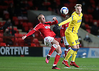 Ben Watson of Charlton and AFC Wimbledon's Joe Pigott challenge for the ball during Charlton Athletic vs AFC Wimbledon, Sky Bet EFL League 1 Football at The Valley on 12th December 2020