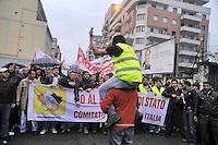 - Milano, manifestazione in via Imbonati a sostegno dei lavoratori stranieri saliti su una ciminiera per protesta contro le leggi sull'immigrazione....- Milan, demonstration in support of foreign workers who climbed up a smokestack in protest against immigration laws