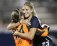 Kristi Eveland #23 hugs Ashley Harris #24 of the Washington Freedom at the end of a WPS match against the Philadelphia Independence on August 4 2010 at the Maryland Soccerplex, in Boyds, Maryland. Freedom won 2-0.