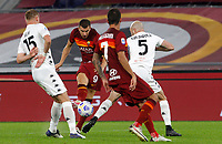 Roma s Edin Dzeko, second from left, kicks the ball during the Serie A soccer match between Roma and Benevento at Rome's Olympic Stadium, October 18, 2020.<br /> UPDATE IMAGES PRESS/Riccardo De Luca