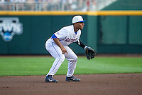 Richie Martin (12) of the Florida Gators fields during a game between the Miami Hurricanes and Florida Gators at TD Ameritrade Park on June 13, 2015 in Omaha, Nebraska. (Brace Hemmelgarn/Four Seam Images)