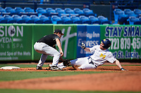 Army West Point third baseman Anthony Giachin (1) tags Miles Lewis (3) out while sliding into third base during a game against the Michigan Wolverines on February 18, 2018 at First Data Field in St. Lucie, Florida.  Michigan defeated Army 7-3.  (Mike Janes/Four Seam Images)