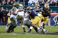 Philadelphia, PA - December 14, 2019:     Navy Midshipmen linebacker Jacob Springer (1) tackles Army Black Knights quarterback Christian Anderson (13) during the 120th game between Army vs Navy at Lincoln Financial Field in Philadelphia, PA. (Photo by Elliott Brown/Media Images International)