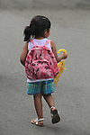 Young Hispanic girl walking in Denver, Colorado. .  John offers private photo tours in Denver, Boulder and throughout Colorado. Year-round Colorado photo tours.