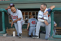 Coach Carlos Mendez (38),left, of the Rome Braves talks with first baseman Chris Garcia (49) priot to a game against the Greenville Drive on July 17, 2011, at Fluor Field at the West End in Greenville, South Carolina. (Tom Priddy/Four Seam Images)