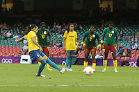 MARTA of Brazil scores the third goal from the penalty spot - Brazil Women vs Cameroon Women - Womens Olympic Football Tournament London 2012 Group E at the Millenium Stadium, Cardiff, Wales - 25/07/12 - MANDATORY CREDIT: Gavin Ellis/SHEKICKS/TGSPHOTO - Self billing applies where appropriate - 0845 094 6026 - contact@tgsphoto.co.uk - NO UNPAID USE.
