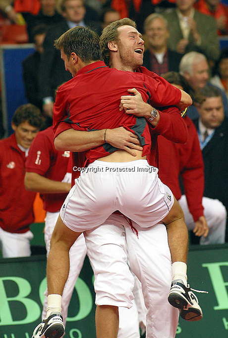 Kratchovil jump in the arms of coach Rosset after beating Holland