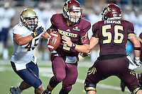 Texas State quarterback Tyler Jones (2) is chased by defensive end Paul Quessenberry (45) during NCAA Football game, Saturday, September 13, 2014 in San Marcos, Tex. Navy leads Texas State 28-7 at the halftime.(Mo Khursheed/TFV Media via AP Images)