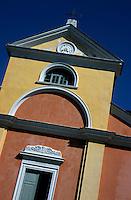 Colorful facade and entrance to the Sainte Julie church in Cape Corse, Nonza, Corsica, France.