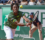 Gael Monfis (FRA) battles against Diego Schwartzman (ARG) at  Roland Garros being played at Stade Roland Garros in Paris, France on May 27, 2015