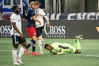 FOXBOROUGH, MA - OCTOBER 19: Andre Blake #18 of Philadelphia Union with a save under pressure from Adam Buksa #9 of New England Revolution during a game between Philadelphia Union and New England Revolution at Gillette on October 19, 2020 in Foxborough, Massachusetts.