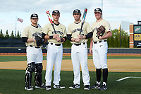 (L-R) Wake Forest Demon Deacons seniors Chris Shafer (25), Bruce Steel (17), Keegan Maronpot (13), and Chris Farish (32) pose for a photo prior to the game against the Liberty Flames at David F. Couch Ballpark on April 25, 2018 in  Winston-Salem, North Carolina.  The Demon Deacons defeated the Flames 8-7.  (Brian Westerholt/Four Seam Images)