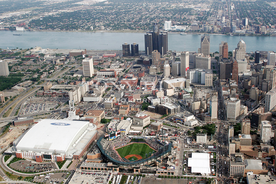 "Aerial view of downtown Detroit with Comerica Park at bottom center, Ford Field at bottom left, and the Renaissance Center at top, taken from on board the Akron, Ohio based ""Spirit of Goodyear"" airship on Monday, July 11, 2005 before the start of the 2005 Major League Baseball All-Stars Home-run Derby. (AP Photo/Tony Ding)."
