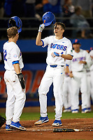 Florida Gators Blake Reese (12) greets Brady McConnell (4) at home after hitting a home run during a game against the Siena Saints on February 16, 2018 at Alfred A. McKethan Stadium in Gainesville, Florida.  Florida defeated Siena 7-1.  (Mike Janes/Four Seam Images)