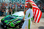 A Tequila Patron grid girl stands on the grid with the #03 Ferrar 458GT driven by Ed Brown and Guy Cosmo before the inaugural American Le Mans Series race on the streets of Baltimore Grand Prix, Maryland on September 3, 2011