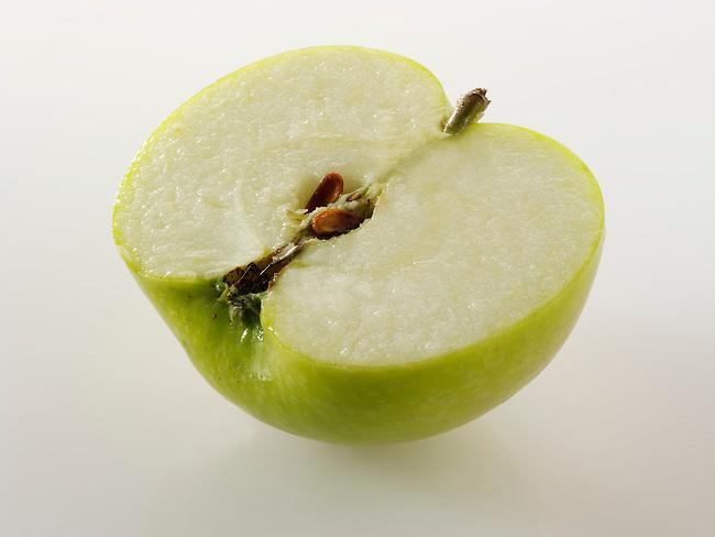 Fresh cut half of a Bramley Apple
