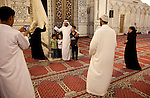 A family of Arab pilgrims takes pictures at the Umayyad Mosque in the Old City. The mosque is one of the three most significant sites in Islam.