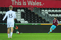 Pictured: Dan Kemp of West Ham United scores his side's third goal during the Premier League 2 match between Swansea City and West Ham United at the Liberty Stadium, Swansea, Wales, UK <br /> Monday 11 March 2019