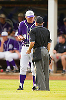 High Point Panthers head coach Craig Cozart #38 argues a call with home plate umpire Alan McGee during the game against the VMI Keydets at Willard Stadium on March 31, 2012 in High Point, North Carolina.  The Panthers defeated the Keydets 2-0.  (Brian Westerholt/Four Seam Images)