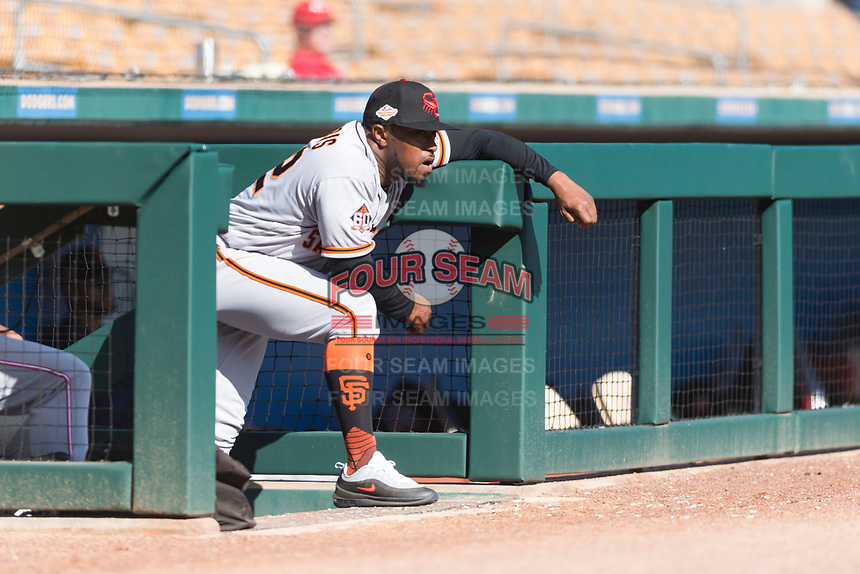 Scottsdale Scorpions manager Willie Harris (22), of the San Francisco Giants organization, looks on from the dugout during an Arizona Fall League game against the Glendale Desert Dogs at Camelback Ranch on October 16, 2018 in Glendale, Arizona. Scottsdale defeated Glendale 6-1. (Zachary Lucy/Four Seam Images)