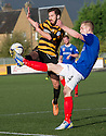 Alloa's Liam Buchanan and Cowdenbeath's Thomas O'Brien challenge for the ball.
