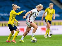 SOLNA, SWEDEN - APRIL 10: Kosavare Asllani #9 of Sweden defends Lindsey Horan #9 of the USWNT dribbles during a game between Sweden and USWNT at Friends Arena on April 10, 2021 in Solna, Sweden.