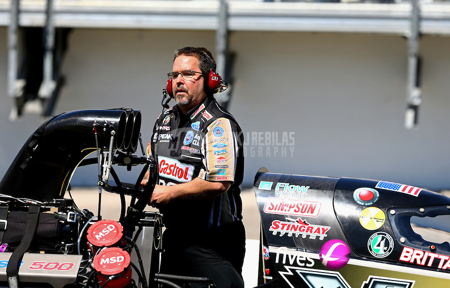 Mar 14, 2014; Gainesville, FL, USA; Dean Antonelli with NHRA top fuel dragster driver Brittany Force during qualifying for the Gatornationals at Gainesville Raceway Mandatory Credit: Mark J. Rebilas-USA TODAY Sports