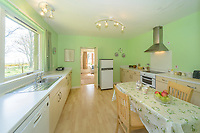 """BNPS.co.uk (01202) 558833. <br /> Pic: KnightFrank/BNPS<br /> <br /> Pictured: Holiday let kitchen.  <br /> <br /> A castle that was burnt down by a pirate, involved in the English Civil War and has been in the same family for five centuries is on the market for offers over £650,000.<br /> <br /> Kilberry Castle, which dates back to the 15th century, has an incredible history and still has a wealth of original features including a 288-year-old mausoleum.<br /> <br /> It sits in 21 acres of land on the Scottish west coast, with stunning views over Kilberry Bay and out to the islands of Islay, Jura and Gigha.<br /> <br /> The four-storey tower house now needs a buyer """"with deep pockets and great imagination"""" to carry out a complete refurbishment but it has a lot of potential."""