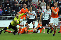 ATTENTION SPORTS PICTURE DESK<br /> Pictured: Lee Trundle of Swansea (C) with Blackpool players watch on as the ball goes off target<br /> Re: Coca Cola Championship, Swansea City Football Club v Blackpool at the Liberty Stadium, Swansea, south Wales. Saturday 24 October 2009