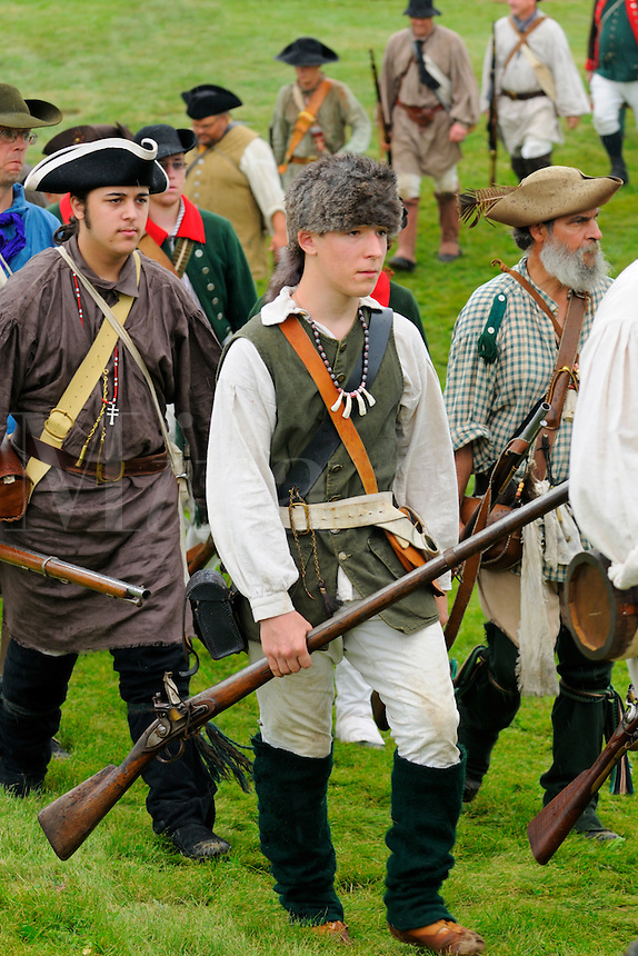 Loyalists, provincial colonists loyal to the British Crown, march in the rain to support British troops during a Revolutionary War re-enactment at Fort Ticonderoga, New York, USA.