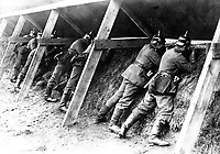 Germans in their well protected trenches on the Belgian frontier showing the men in the act of aiming at their enemy.  Underwood & Underwood. (War Dept.)<br /> Exact Date Shot Unknown<br /> NARA FILE #:  165-WW-287A-2<br /> WAR & CONFLICT BOOK #:  633