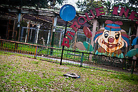 A rusted sign of the children's amusement park at the Havana Zoo, Havana, Cuba, 12 February 2011. The largest and the oldest zoo in Cuba (founded in 1939) is located in a centric neighborhood of the capital. Since the 1990s Cuba struggles with chronic economic crisis and therefore the strong marks of rundown and lack of sources are evident within the whole zoological garden. A lot of cages are empty and out of use for long time, the remaining animals are captured in poorly maintained pits. Concrete enclosures have no vegetation, all facilities are unkept. The food supply is often inadequate and visitors throw junkfood to the animals because there are no zookeepers around.