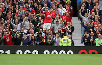 Pictured: Wayne Rooney of Manchester United jumps in the air celebrating his equaliser making the score 1-1. Saturday 16 August 2014<br />