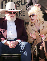 06 July 2020 - Country music and southern rock legend Charlie Daniels has passed away after suffering a stroke. The Grand Ole Opry member and Country Music Hall of Famer was 83. File Photo: November 8, 2009 - Nashville, TN - Charlie Daniels and Dolly Parton. Music City Walk of Fame inductions held at Hall of Fame Park in downtown Nashville. Photo Credit: Eddie Malone/AdMedia