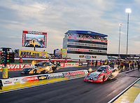 Aug 29, 2014; Clermont, IN, USA; NHRA funny car driver Chad Head (right) races alongside Tony Pedregon during qualifying for the US Nationals at Lucas Oil Raceway. Mandatory Credit: Mark J. Rebilas-USA TODAY Sports