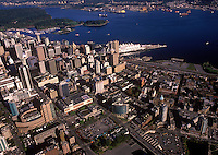 Aerial view of city center looking west.  Public Library main branch - foreground left, Canada Place - center.  Vancouver, BC, Canada