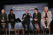 President George W. Bush participates in  a panel to discuss his health care initiatives at the National Institute of Health in Bethesda, Maryland on January 26, 2005.  left to right::  Jess Patton, Associations Marketing Group, Tamuni Fleming, Program Director, Health Care for All. Potus William Lomel, Owner Titan Roof, IIC, Patricia Zakula, Executive Director Children First Center.   <br /> Credit: Dennis Brack / Pool via CNP