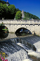 The 13th Century Abbey on the Dordogne River in Brantome, France, visible beyond a bridge, dam, waterway. ancient architecture, religions, Christianity,. BRANTOME FRANCE.