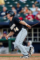 Bobby Kielty (54) of the San Antonio Missions follows through on his swing during a game against the Northwest Arkansas Naturals at Arvest Ballpark on June 30, 2011 in Springdale, Arkansas. (David Welker / Four Seam Images)