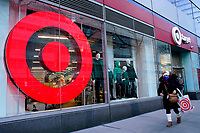 NEW YORK, NEW YORK - MARCH 02: A woman leaves Target store on March 02, 2021 in New York. Target hopes to build a growth by investing about $ 4 billion annually for the next years to accelerate the consolidation of new stores, upgrade existing ones and enhance its capacity to fulfill online orders. (Photo by Emaz/VIEWpress)