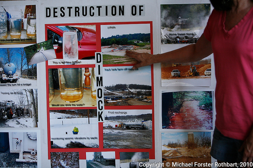 "In Dimock, PA, Victoria and Jimmy Switzer are among 14 families along Carter Road whose drinking water wells became contaminated with methane and other chemicals after gas drilling on their properties. Cabot Oil and Gas, the company held responsible by the Pennsylvania Department of Environmental Protection, has had at least 21 spills in Dimock township in less than two years. <br /> <br /> ""Here we're in the middle of three wells,"" says Victoria Switzer, ""710 feet this way, 1435 feet up the hill and 1375 feet there. And that's pretty much how it plays out. There's no spacing regulations."" Despite not being able to drink their water and a pending lawsuit against Cabot, the Switzers have continued to build their new family home and plan to stay.<br /> <br /> Hydraulic fracturing or ""fracking"" is new method of drilling for natural gas: millions of gallons of water, sand and proprietary chemicals are pumped down a well under high pressure. The pressure fractures the shale, opening fissures so that natural gas can flow more freely. In August 2010, fracking is being widely used in the Marcellus Shale formation under Pennsylvania while New York considers a moratorium until the environmental effects can be reviewed. <br /> <br /> The 2005 Energy Policy Act exempted natural gas drilling from the Safe Drinking Water Act. Scientists have identified volatile organic compounds (VOCs) such as benzene, ethylbenzene, toluene, methane and xylene that have been found in contaminated drinking water near drilling sites. On the other hand, gas companies and property owners stand to earn up to one trillion dollars in profits from drilling in the Marcellus Shale.<br /> <br /> © Michael Forster Rothbart<br /> www.mfrphoto.com <br /> 607-267-4893 o 607-432-5984<br /> 5 Draper St, Oneonta, NY 13820<br /> 86 Three Mile Pond Rd, Vassalboro, ME 04989<br /> info@mfrphoto.com<br /> Photo by: Michael Forster Rothbart<br /> Date: 8/2010    File#:  Canon 5D digital camera frame 68343"