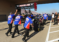 Jul, 8, 2011; Joliet, IL, USA: Crew members push the car of NHRA top fuel dragster driver Shawn Langdon during qualifying for the Route 66 Nationals at Route 66 Raceway. Mandatory Credit: Mark J. Rebilas-
