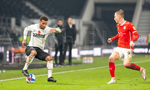 7th November 2020; Pride Park, Derby, East Midlands; English Football League Championship Football, Derby County versus Barnsley; Nathan Byrne of Derby County sdrags back the ball watched by Cauley Woodrow of Barnsley