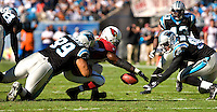 Carolina Panthers defensive tackle Maake Kemoeatu (99) dives for a loose ball against Arizona Cardinals during an NFL football game at Bank of America Stadium in Charlotte, NC.