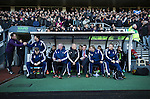 Derby County 1 Nottingham Forest 2, 17/01/2015. iPro Stadium, Championship. Visiting manager Stuart Pearce (in suit), sitting in the away dugout at the iPro Stadium before Derby Country's Championship match against Nottingham Forest. The match was won by the visitors by 2 goals to 1, watched by a derby-day crowd of 32,705. The stadium, opened in 1997, was formerly known as Pride Park. Photo by Colin McPherson.