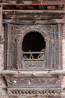 Nepal, Patan.  Carved Woodne Window Frame of Old House.