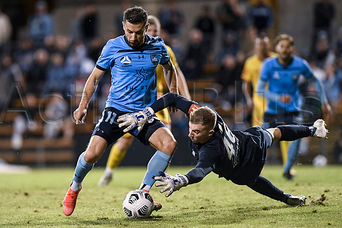 18th April 2021; Leichardt Oval, Sydney, New South Wales, Australia; A League Football, Sydney Football Club versus Adelaide United; Joe Gauci of Adelaide United dives at the feet of Kosta Barbarouses of Sydney