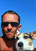 """Copy picture of Richard Best, left, with his pet dog.<br /> Re: The parents of Richard Best, who died in an accident that left him with a serious head injuries after tripping over his own flip flop have paid tribute to him as """"a life-long Cardiff supporter who touched the hearts of everyone"""".<br /> Around 1,000 will attend the funeral of Richard Best, who died in the accident in the early hours of July 3, 2018.<br /> """"He was so well loved by everyone."""" said his mum Pam.<br /> """"I just can't believe how many hearts he touched. I find it hard to still accept it, at times I am in denial and other times I realise what has happened.""""<br /> The family's home in Baglan, south Wales has been inundated with cards and flowers since Richard, who worked at the steelworks in Port Talbot, was found with a head injury."""